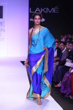 Mandira Bedi Lakme Fashion Week Summer 2014 blue shades and gold sari. More here: http://www.indianweddingsite.com/mandira-bedi-lakme-fashion-week-summer-resort-2014/