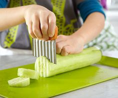 Teach your child to tuck his fingers under his knuckles as he slices and dices to avoid mishaps in the kitchen.