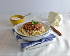 The answer to an Italian bolognese, a Greek meat sauce is different in the sense of flavors.
