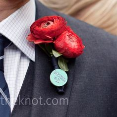 red Ranunculus wedding flower boutonniere, groom boutonniere, groom flowers, add pic source on comment and we will update it. www.myfloweraffair.com can create this beautiful wedding flower look.