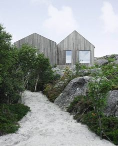 This family vacation cottage on a remote Norwegian island was modeled on traditional boat sheds. It has 3 bedrooms in 1,507 sq ft. | www.fac...