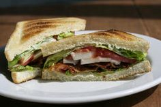 Add sliced apples for a twist on the BLT -- The aioli spread in this sandwich is made with cider and sour cream instead of mayonnaise to give it a sweet and tangy taste.