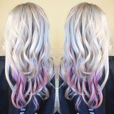 Platinum blonde hair with pastel pink balayage peekaboo highlights