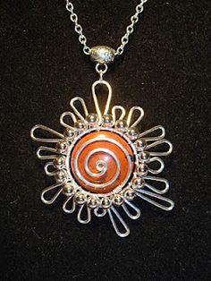Spiral sun pendant