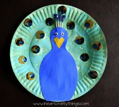 Paper Plate Peacock Craft from I Heart Crafty Things. Goes great with book Three Hens and a Peacock by Lester Laminack.