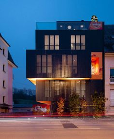 Monolithic apartment building with post-graffiti art