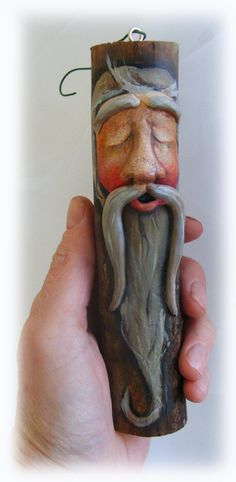 Clay carved wood spirit santa ornament made from tree branch