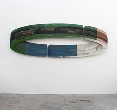 Ron van der Ende - sculptor - He specializes in wall mounted bas-reliefs constructed from found wood.