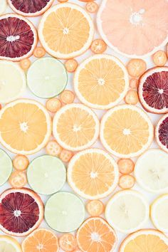 This food photography print features sunny, sweet citrus fruit in pastel shades; grapefruit, navel oranges, blood oranges, tangerines, lemons, limes