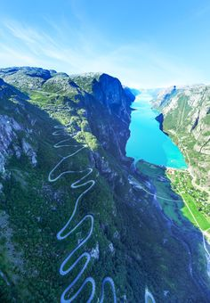 Originally from Brighton, the fine art art photographer yearns to take the perfect shot, which is why he is shows extreme diligence when setting up and snapping each image, like this one (above) captured from a helicopter hovering above Lysefjord Beautiful Norway, Beautiful Roads, Beautiful Places To Visit, Places Around The World, Travel Around The World, Places To Travel, Places To See, Norway Fjords, Dangerous Roads
