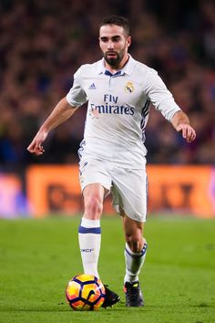 Daniel Carvajal of Real Madrid CF conducts the ball during the La Liga match between FC Barcelona and Real Madrid CF at Camp Nou stadium on December 3, 2016 in Barcelona, Catalonia.