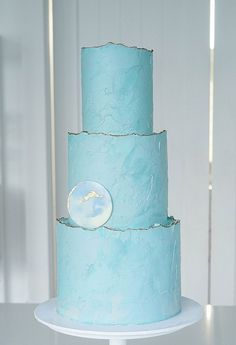 Contemporary Wedding Cakes by Don't Tell Charles ~ Texture and uneven edges in this three tier blue buttercream beauty