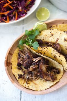 A meltingly tender recipe for Five Spice Pulled Pork ( or beef!)  Tacos with Asian Cabbage Carrot Slaw and Spicy Aioli - this can be made in the oven or slow cooker. | www.feastingathome.com