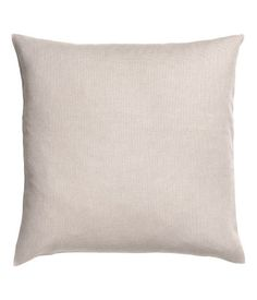 Light beige. Cushion cover in cotton canvas with a concealed zip.