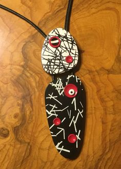 Polymer clay and leather necklace from Annie Jacobi Jewelry.