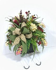 Headstone Saddle, Cemetery Flowers, Grave Decorations, Memorial Flowers, Headstone Flowers, Gravestone Flowers, Cemetery Decorations This is a cemetery floral basket arrangement attached to a headstone saddle. The wicker style basket is dark brown. It's full of spring Lilly's,