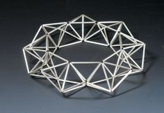 bracelet, a series of tetrahedrons made from tubes of sterling silver  #geometric  #bracelet  #silver  #tetrahedron