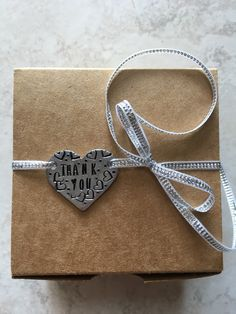 first hand stamped project, a little heart tag...I make these and they are available in my Etsy shop.