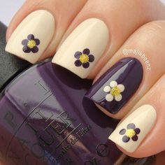 Love the cream and purple. Although I wouldn't put flowers on every finger but two of them would be very pretty!