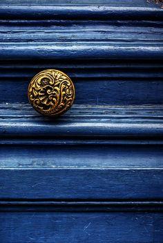 Gold knob Blue door