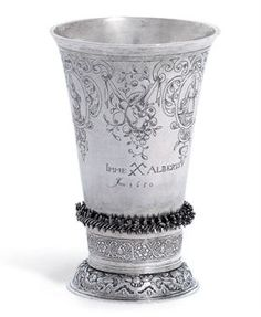 A DUTCH SILVER BEAKER  MARK OF HENDRICK VAN LAER, GRONINGEN, 1651-52  Tapering cylindrical, the sides engraved with foliage scrolls and ribbon-tied fruiting swags, further engraved 'Imme Alberts' and dated '1650', applied above the spreading foot with foliage band, marked underneath  5¼ in. (13.5 cm.) high  6 oz. (187 gr.)