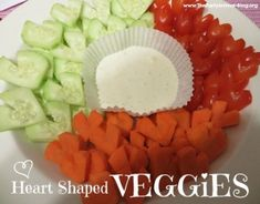 Heart Shaped Veggies for Valentine's Day from The Party Animal.  Healthy snacks for kids or party.  Shows how to cut cucumbers, grape tomatoes & carrots in to heart shapes.  Serve with ranch dressing, hummus or favorite dip.