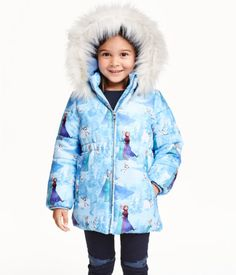 Patterned, padded jacket. Detachable lined hood with faux fur trim. Zip at front, elastication at waist, side pockets, and inner ribbing at cuffs. Partly fleece-lined.