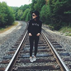 Fashion blogger Julie Denby in checkerboard and black.