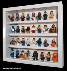 Handcrafted hardwood display case for Lego minifigures  1ft x 1ft  Holds 32+ minifigs by AyrowStudios on Etsy https://www.etsy.com/listing/172783038/handcrafted-hardwood-display-case-for