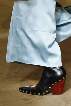 Celine makes a strong case for cowboy boots.