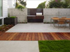 BBQ area in modern style with concrete and weathered steel