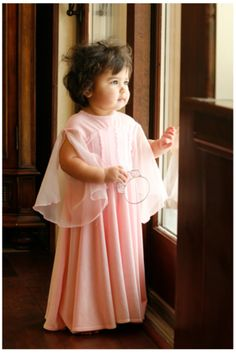 Toddler in pink Appleblossom dress at the window