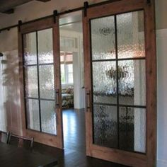 Liking the glass in these decorative sliding barn doors. #HomeChannelTV #hometours #videos #photos #WeblinkInBio