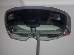 The PC maker's chairman is talking with Microsoft about becoming the first outside company to build a version of Microsoft's glasses that overlay digital images on the real world.