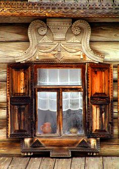 Novgorod, Russian Federation Window. The weathered and carved wood, the simple sheer curtain, the pottery on the windowsill... everything here is all natural; all love.