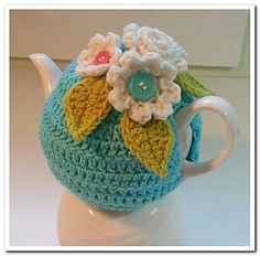 Kerri's Kozy is designed to fit your average 4 cup/32 oz Brown Betty teapot. It is stretchy enough and has an adjustable button closure so that it will fit a variety of differently shaped teapots, making it fairly universal. It is worked from the top down and includes the instructions for the three flowers as well.