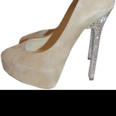 Jimmy Choo pumps with blinged out heels
