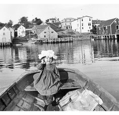 Little girl sitting in boat near Guysborough waterfront ca. 1910