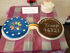 Designed this cake for Girl Scout Bridging ceremony from Daisies to Brownies. Bridge is made with a base of rice krispy treat covered with Fruit Twizzlers and white icing. The cake on the right is actually a brownie... Get it?!?! :)