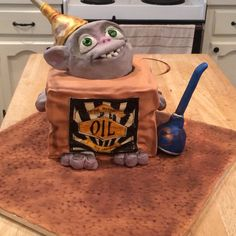 Masons 8th birthday cake. Oil can the boxtroll.