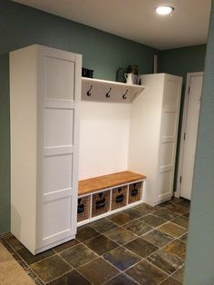 Ikea mudroom hack: Pax closets, ekby shelf and corbels, gerton desk top, kallax bench seat, and pjas baskets.