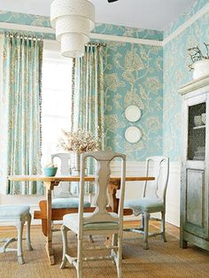 Soft aqua paired with over-sized beige flowers give this pattern a fresh twist on cottage style. It's perfect in a dining room, paired with simple wainscot. I'm not usually one for matching curtain fabric, but it feels playful and fun here, don't you think? You can't go wrong with blue and white, especially when it's aqua...