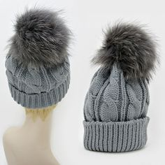 Warm Chic Gray Knit Beanie Winter Hat  With Genuine Raccoon Fur Pom Pom. Get the lowest price on Warm Chic Gray Knit Beanie Winter Hat  With Genuine Raccoon Fur Pom Pom and other fabulous designer clothing and accessories! Shop Tradesy now