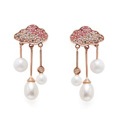 These Cloud Raindrop earrings by Emily Richardson feature a combination of round and baroque pearls falling from cloud studs pavéd with pink sapphires and diamonds. Discover the up and coming jewellery designers that you need to know breaking the boundaries of conventional fashion design in the luxury industry: http://www.thejewelleryeditor.com/jewellery/article/jewellery-designers-to-watch-2017/ #jewelry
