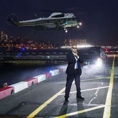U.S. Secret Service Agents stand guard as Marine One with President Barack Obama on board prepares to land at the Downtown Manhattan Heliport in New York City on November 2 2015. Obama was traveling to attend Democratic fundraisers. Photograph by Saul Loeb of @afpphoto@gettyimages. by time