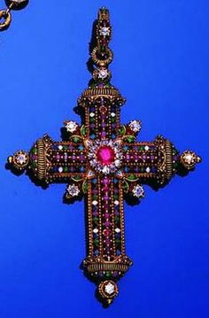 A 19th century gold, enamel and gem-set cross pendant and chain, attributed to Frédéric Boucheron, circa 1885-1895.