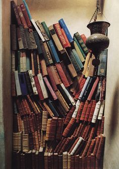 Barrage of books. There is a bookstore I love in India which has books stacked like this all over the store.  The owner knows just where to find everything.
