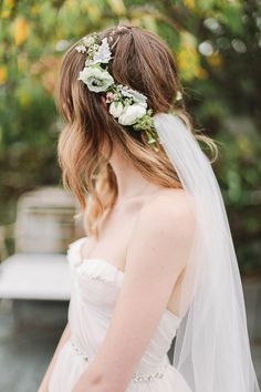 Such a pretty veil and crown! I'd go for less veil material.
