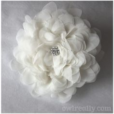 A FABULOUS flower tutorial. I know there are lots of these but this one is easy and so beautiful! From owlreally.blogspot.com