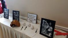 Instead of a sign in book, we put vintage baseball photos for decor & had guests sign baseballs & mitts. We now have them in a glass case in the boys' nursery.